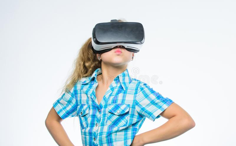 Little girl in virtual reality goggles. kid use modern technology. Little kid in VR headset. Digital future and royalty free stock images