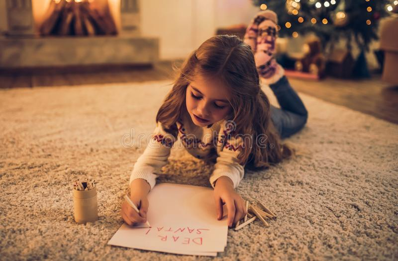 Little girl waiting for Christmas royalty free stock image