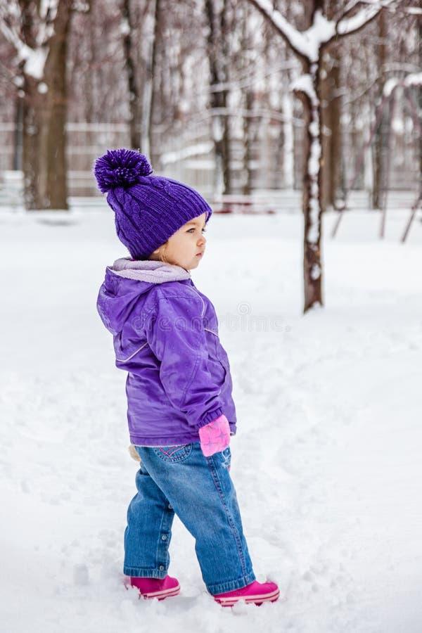 Little girl walking alone outside, kids full height portrait. royalty free stock photo
