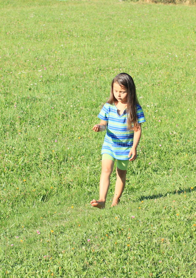 Download Little Girl Walking Barefoot Stock Photo - Image of shirt, walk: 33478200