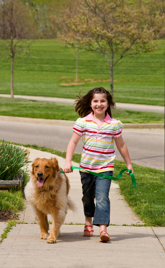 Free Little Girl Walking Dog Stock Photo - 5121590