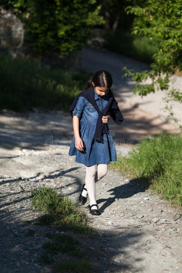 Little girl walking home. royalty free stock photos