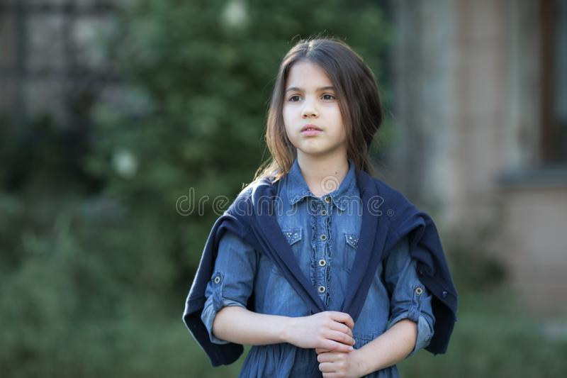 Little girl walking and looking on smth. royalty free stock photos
