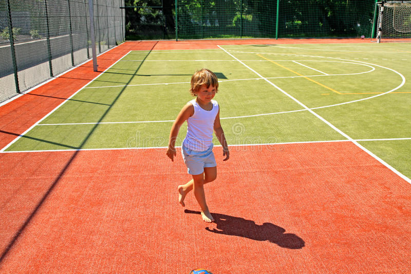 Download A Little Girl Walking On The Pitch Stock Image - Image: 17879041
