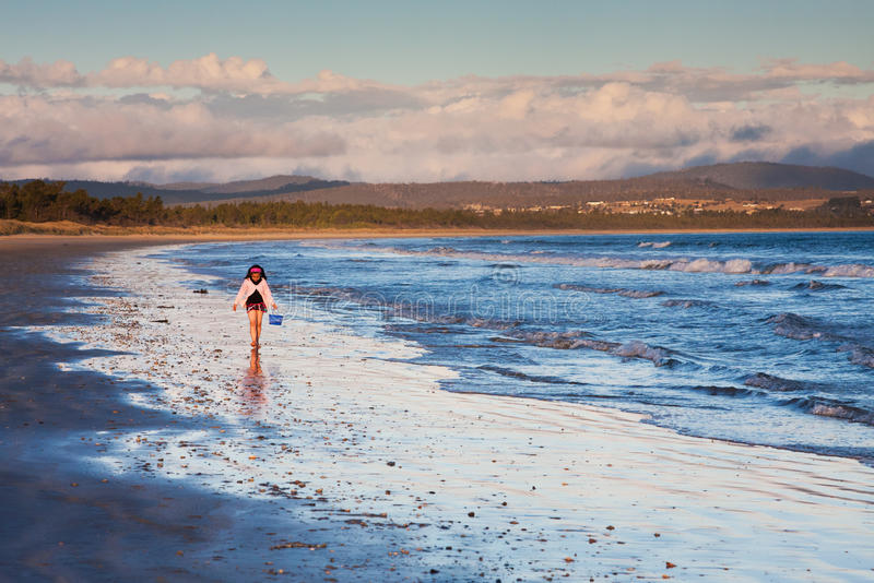 Download Little Girl Walking On Shore At Sunset Stock Photo - Image: 17383292
