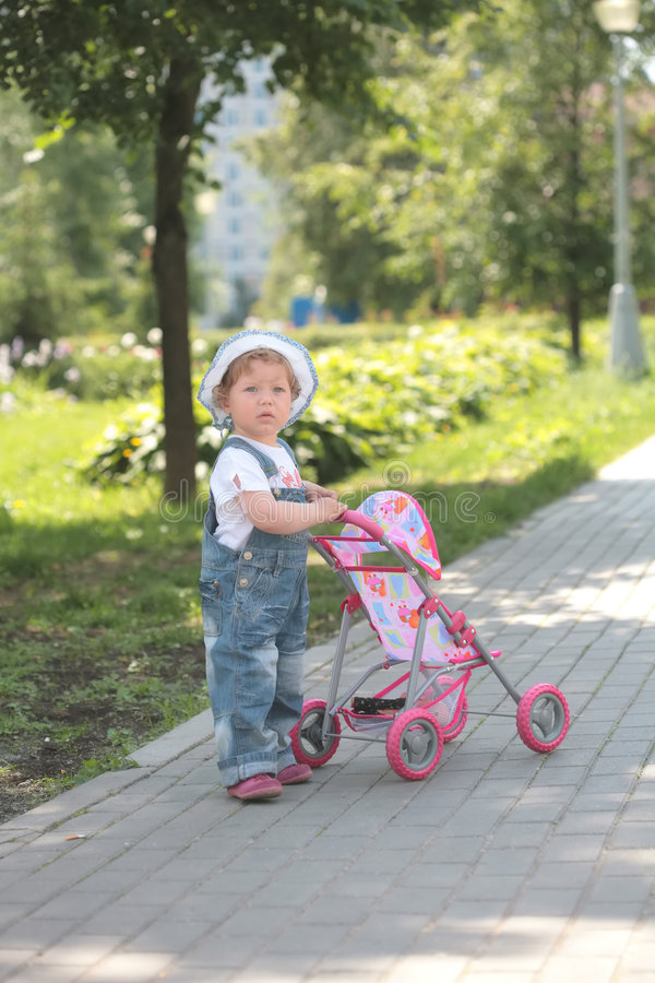 Little Girl Walks With Toy Sidercar Royalty Free Stock Photo
