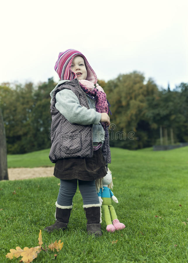 Little girl in warm autumn clothing