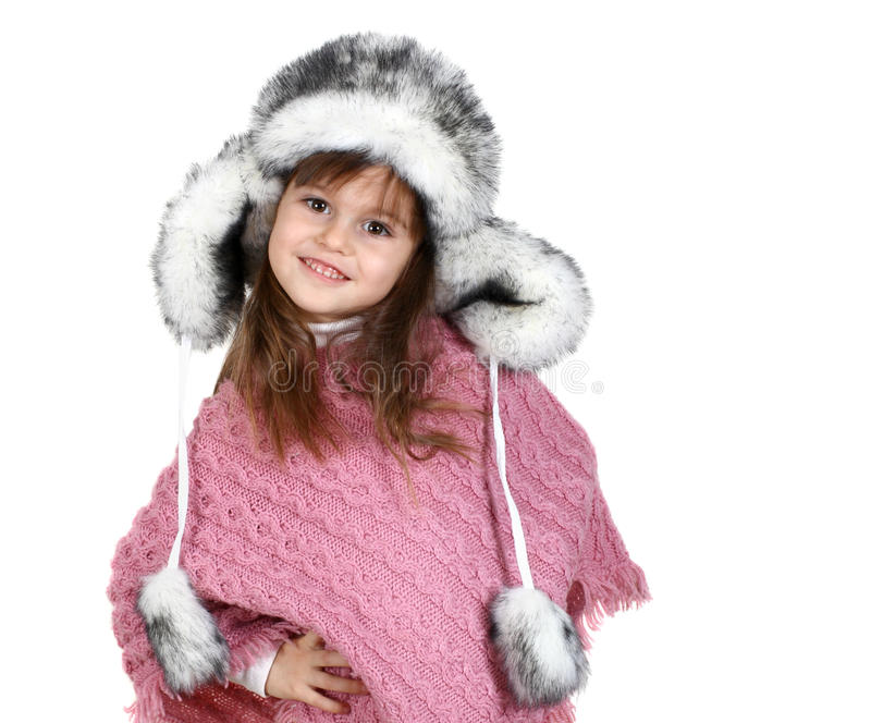 Little girl in warm hat royalty free stock photo
