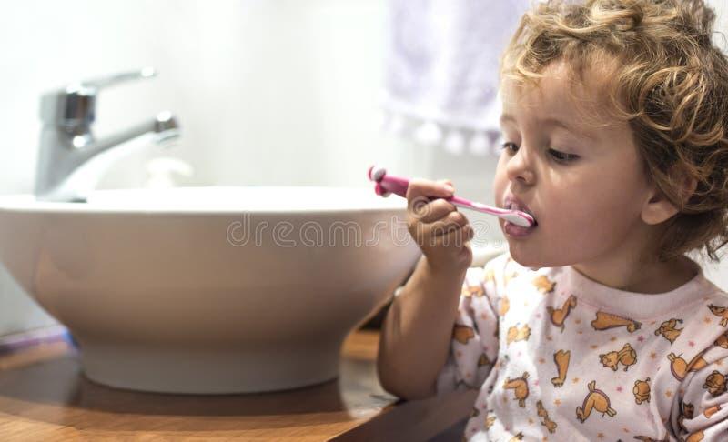 Little girl washing teeth royalty free stock image