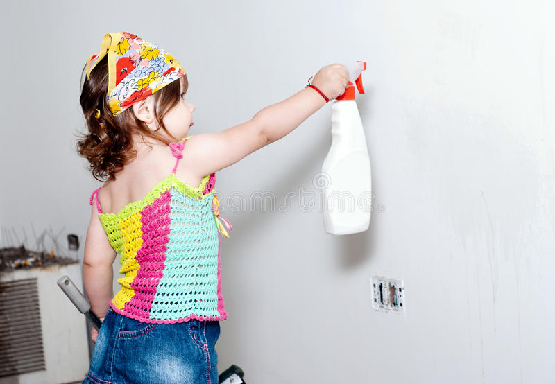 The little girl washing a wall royalty free stock images