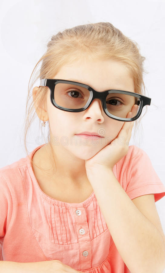 Little girl watching stock photography