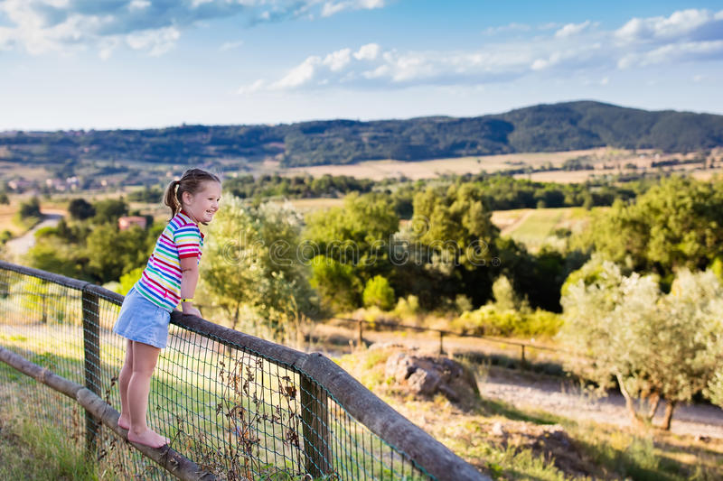 Little girl watching landscape in Italy royalty free stock images