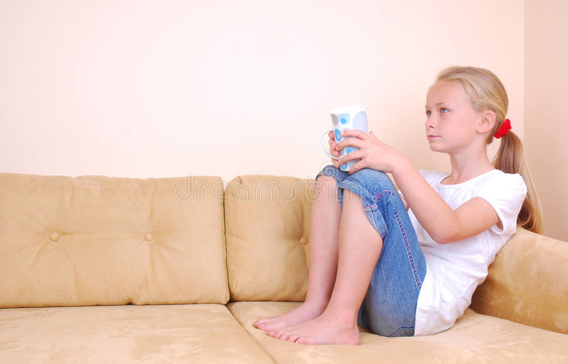 Little Girl Watching TV Stock Photo
