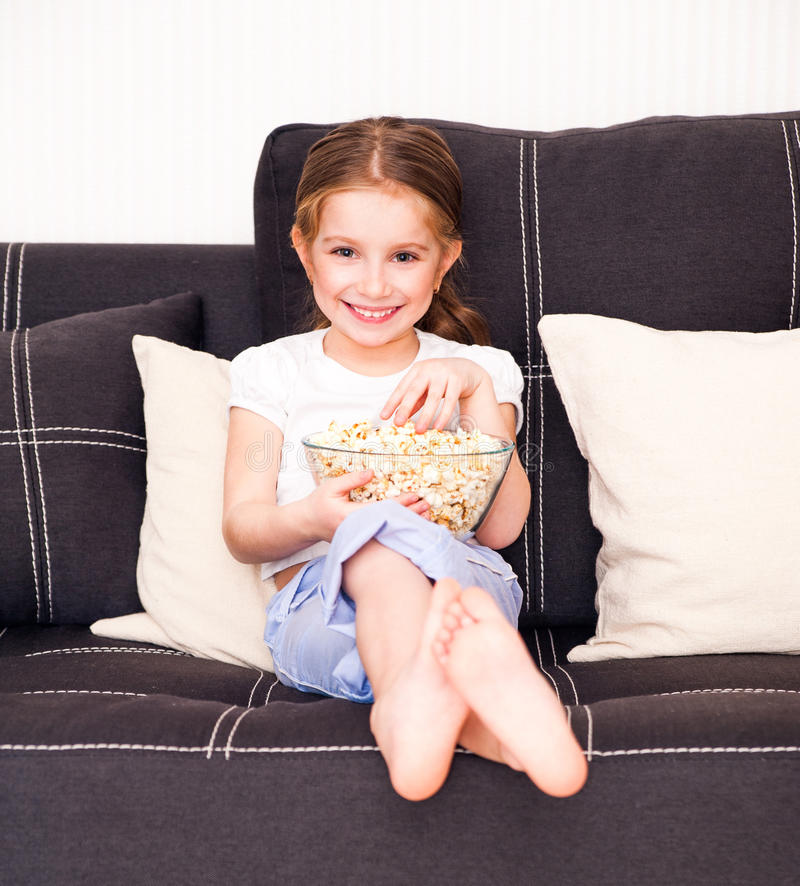 Download Little girl watching TV stock photo. Image of cute, person - 37701370