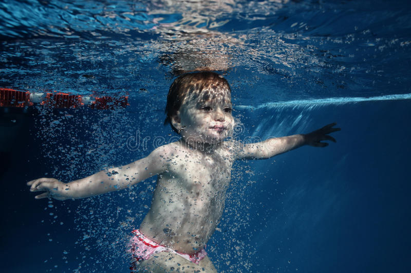 underwater water park. Download The Little Girl In Water Park Swimming Underwater And Smiling Stock Image -