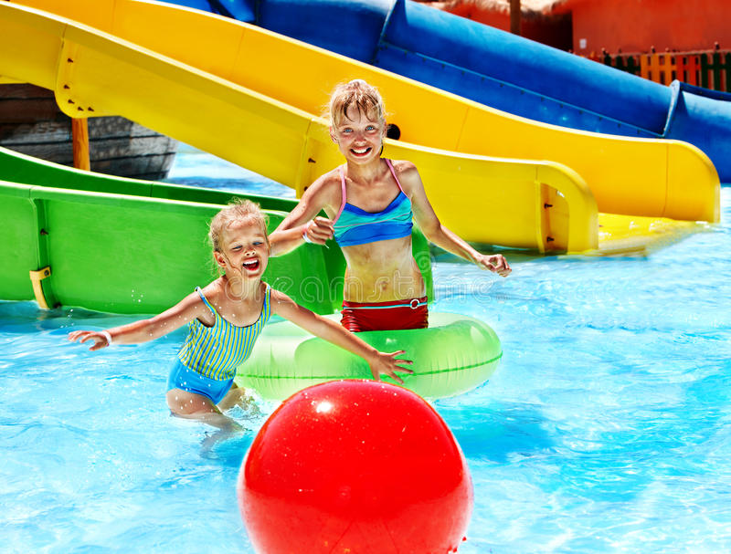 Download Child On Water Slide At Aquapark. Stock Photo - Image: 30021358