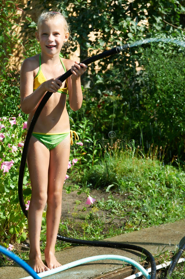 Free Little Girl Watering The Garden Stock Image - 27348051
