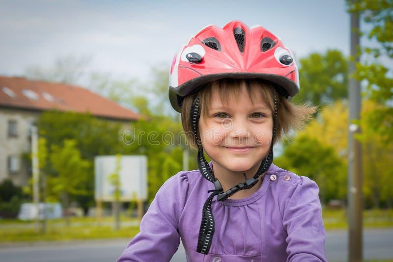 Little Girl Wear Sports Helmet stock images