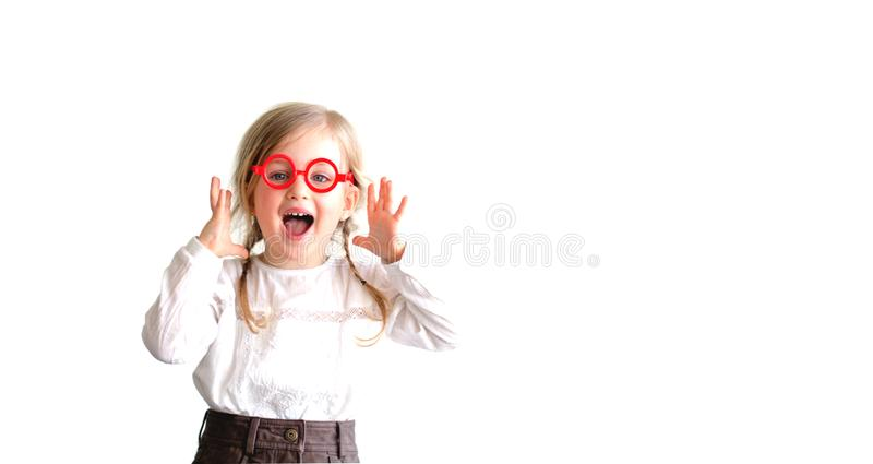 Little girl wearing big round glasses and making a silly expression royalty free stock image