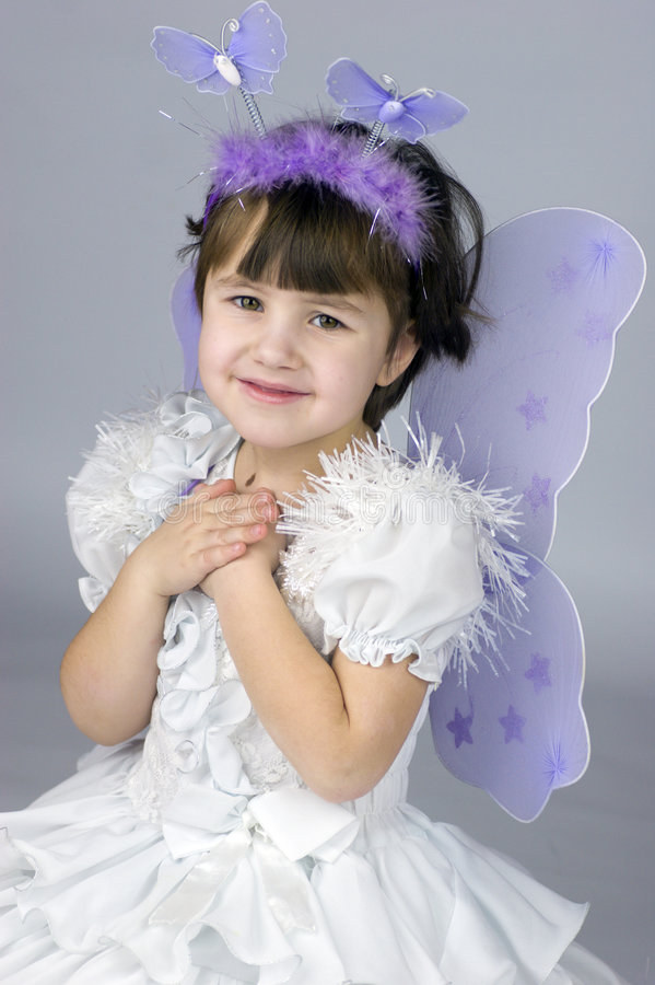 Little girl wearing fairy costume stock photo