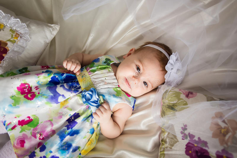 Little girl wearing a flowered dress royalty free stock photo