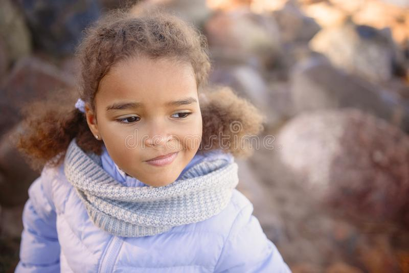 A little girl, wearing a hat and barefoot lends a glimpse of the sun. Journey with the concept of children royalty free stock images
