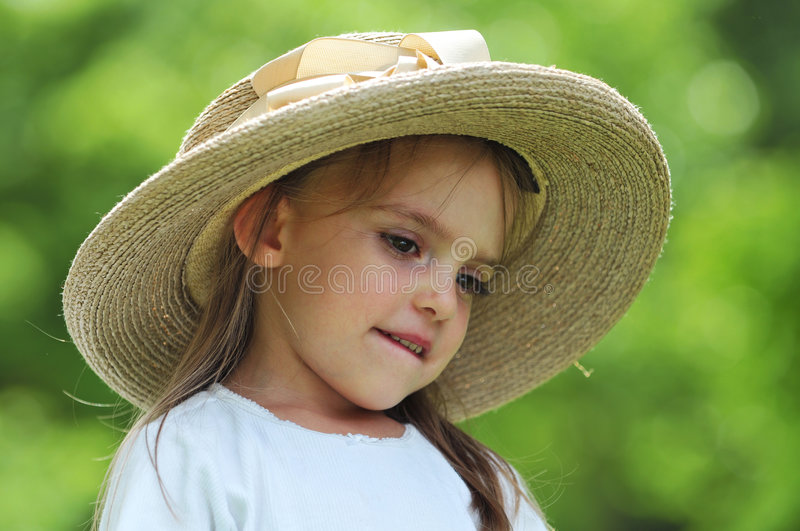 Little girl wearing a hat outdoors royalty free stock photography