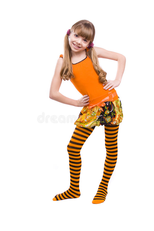 Little girl wearing orange dress is standing royalty free stock images