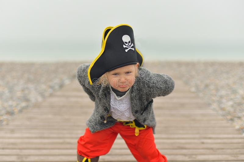 The little girl is wearing a pirate costume stock image