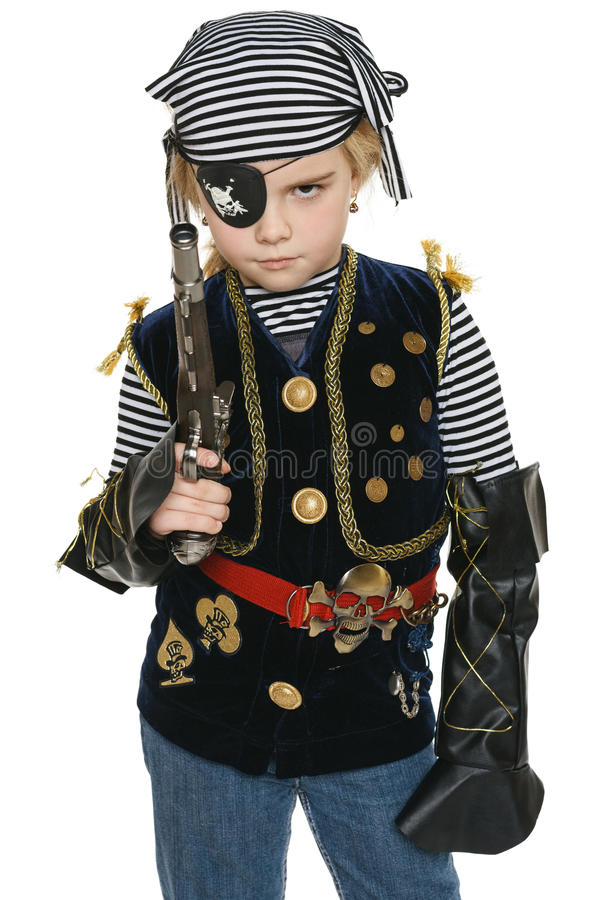 Little girl wearing pirate costume holding a gun royalty free stock photography