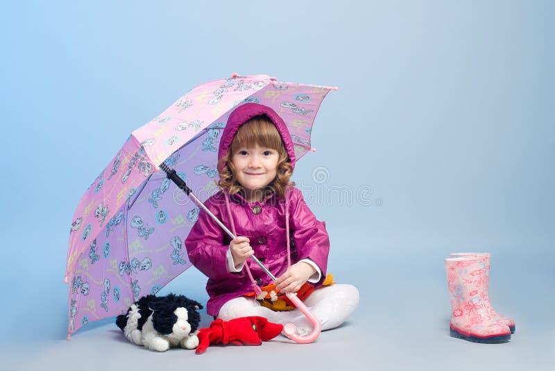 Little girl wearing raincoat stock photos