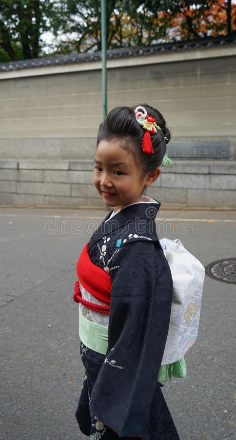 A little girl wearing traditional dress kimono stock images