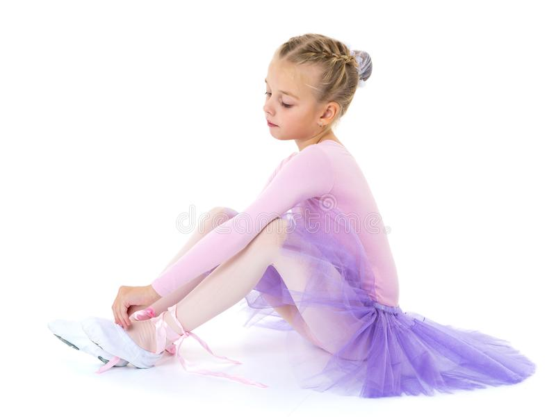 Little girl wears ballet shoes. royalty free stock photography