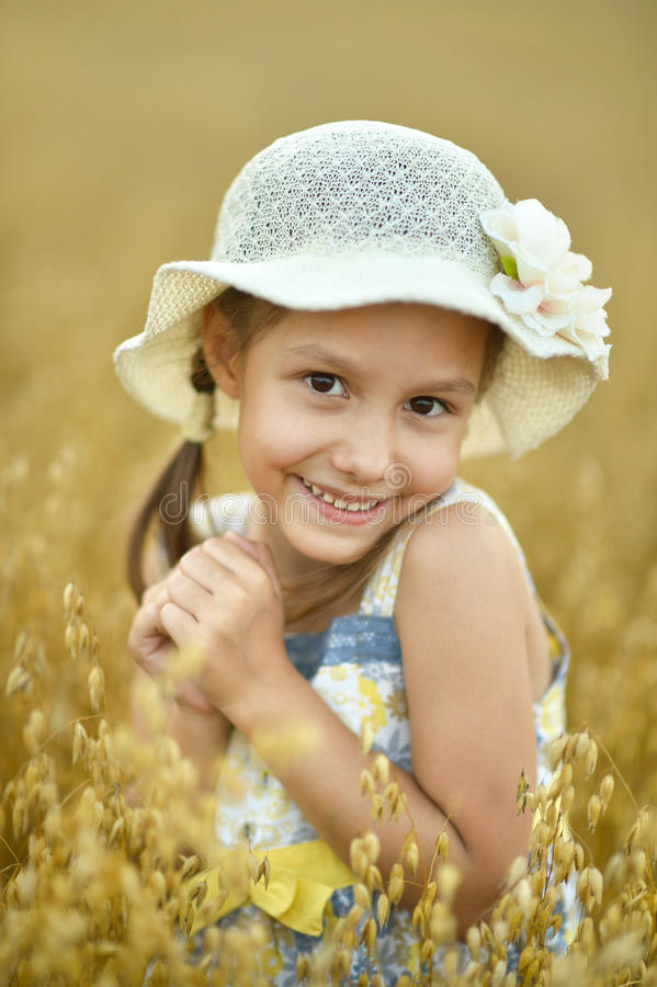 Little girl in wheat field. Cute little girl in the wheat field royalty free stock images