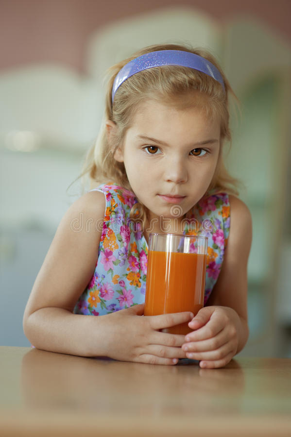 Download Little Girl, Which Sits On Table Stock Image - Image: 26913789