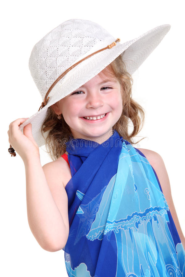Little girl in a white bonnet. On the white background royalty free stock photography