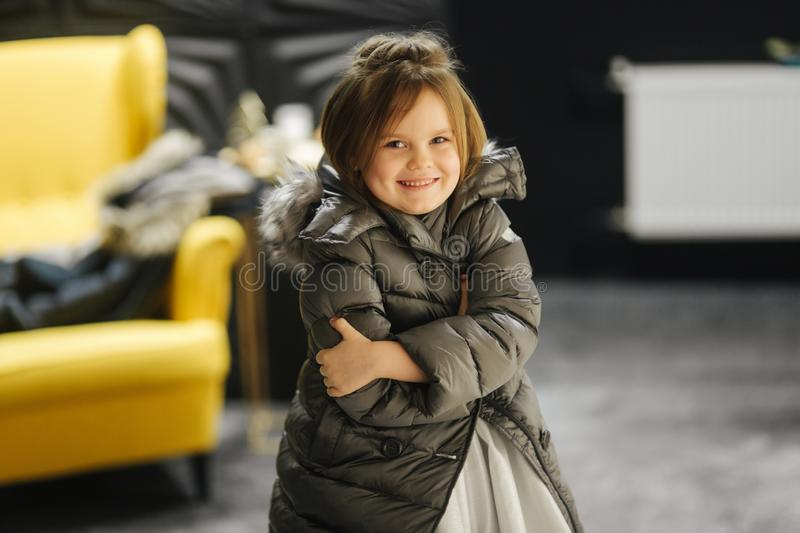 Little girl in white dress and jaket at studio. Happy girl smile royalty free stock photography