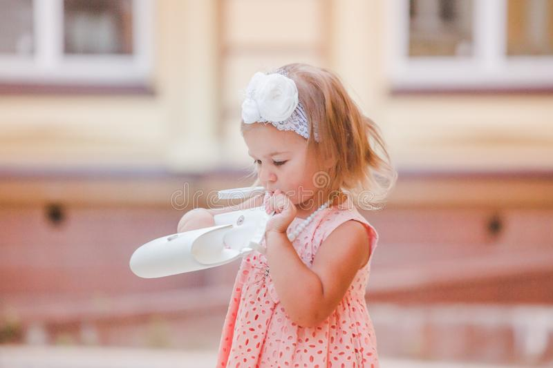 Little Girl checks contents of bags after shopping. royalty free stock images