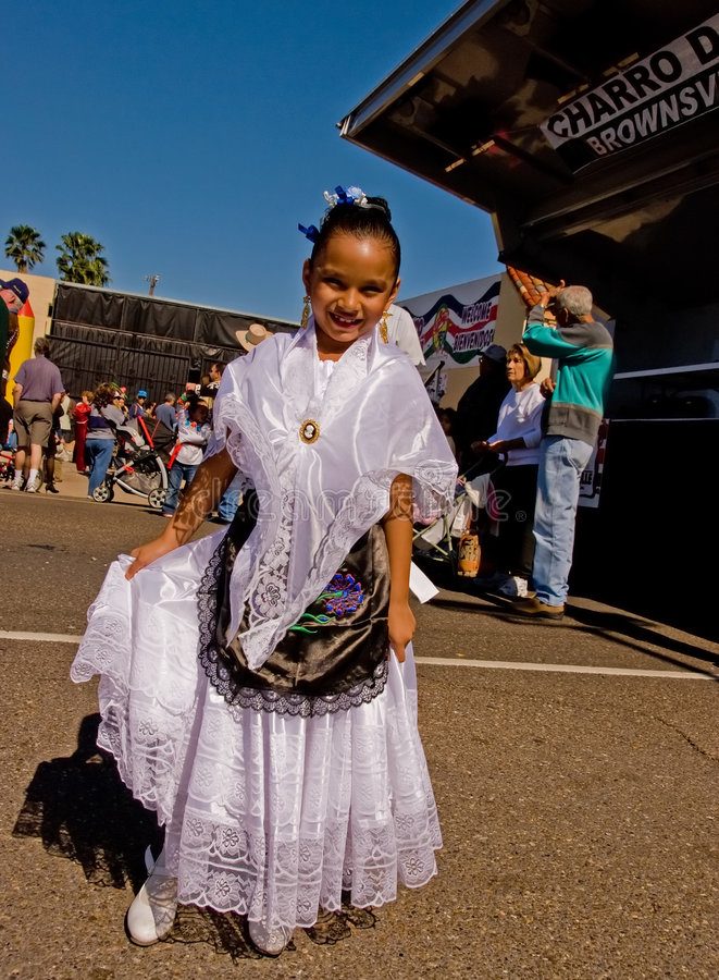 Little girl in white Mexican costume royalty free stock image