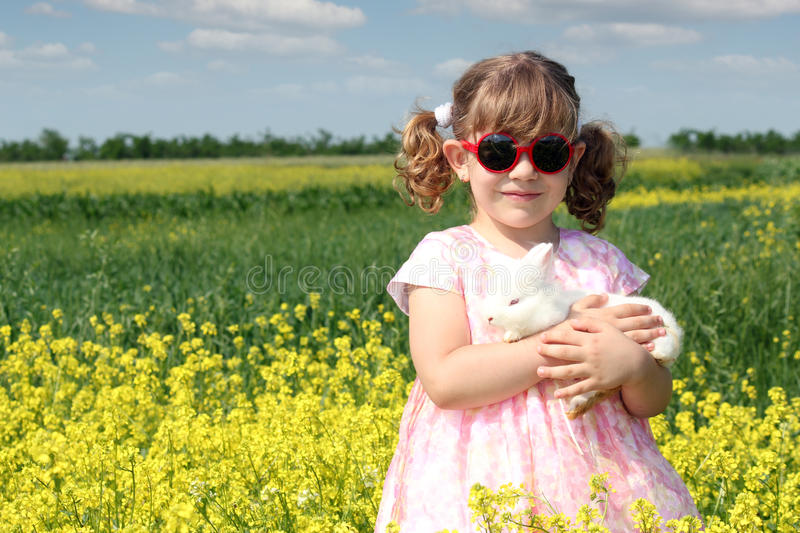 Download Little Girl With White Rabbit Stock Images - Image: 28568364