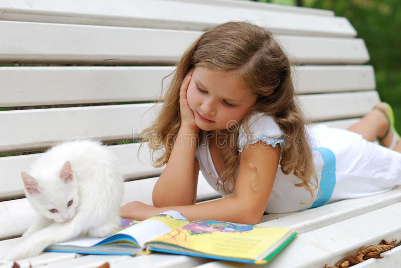 The little girl whith a book royalty free stock photos