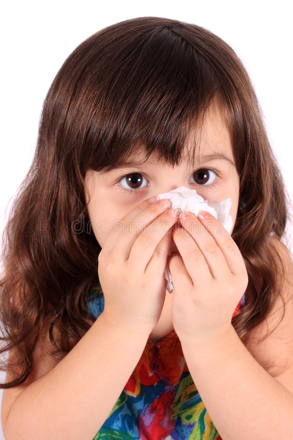 Little girl wiping nose with tissue royalty free stock image