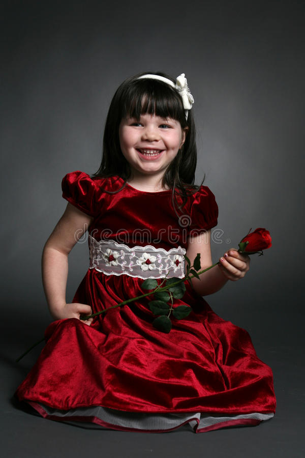 Free Little Girl With Red Satin Dress And A Rose Royalty Free Stock Photos - 16147038