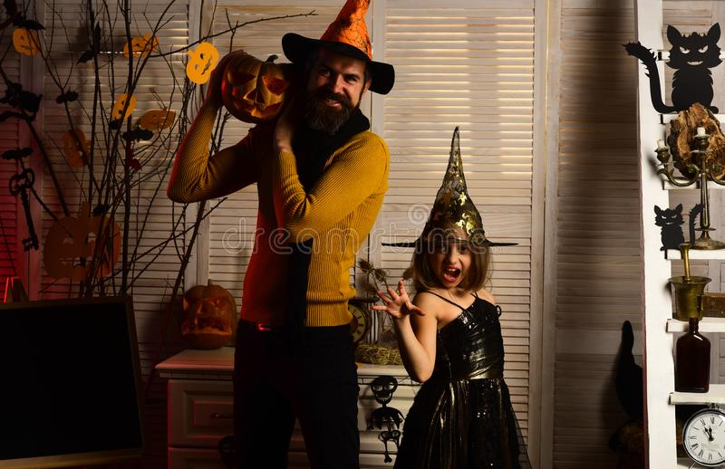 Little girl in wiz hat with creepy hands. Little girl and father do wiz magic. Happy family celebrate halloween. Happy. Halloween, keep the party going. Join us stock images