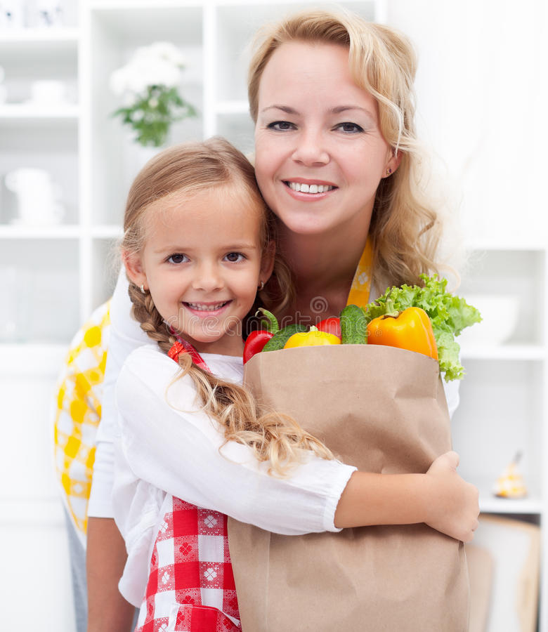 Download Little Girl And Woman With The Groceries Stock Image - Image: 21922285