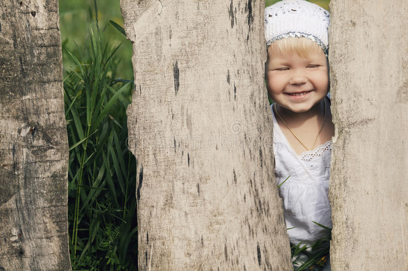 Download Little Girl And Wooden Fence Stock Photo - Image: 33126368