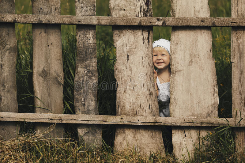 Download Little Girl And Wooden Fence Stock Photo - Image: 33126404