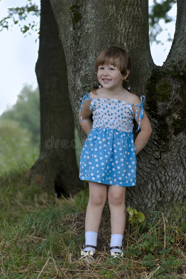 Little girl in the woods stock image