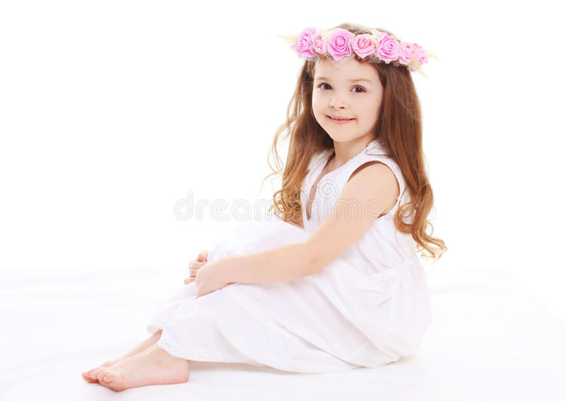 Little girl with a wreath of flowers on head stock photo