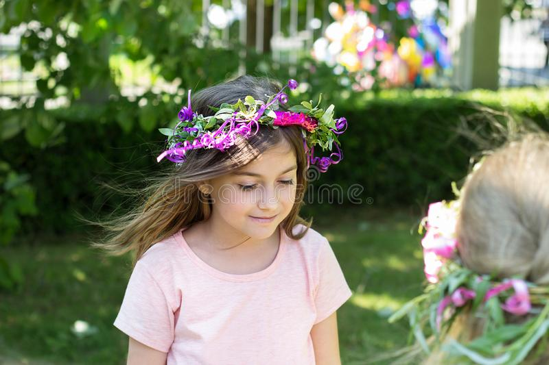 Little girl with wreath of flowers on her head, celebrating Lazarus saturday stock photos